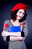 Beautiful young Frenchwoman with notebook