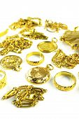 picture of dowry  - Vertical shot of Gold in varies jewelry form on white isolated background - JPG