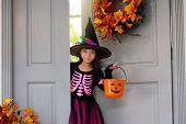 Kids Trick Or Treat. Halloween. Child At Door. poster