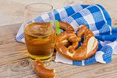 Traditional Of German Pretzel And Glass Of Beer On Wooden Background. Salted Pretzel Is Traditional  poster