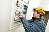 One electrician builder at work installing energy saving meter into electric line distribution fuseb