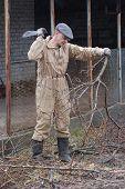 foto of machete  - Gardener with machete  Near Kiev - JPG