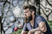 Man Long Beard Relaxed With Smoking Habit. Man With Beard And Mustache Breathe Out Smoke. White Clou poster