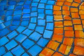 Street Mosaic Pattern Of Orange And Blue Stone. Beautiful Mosaic Pattern Close Up. Blue And Orange T poster