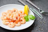 Shrimps Served On Plate With Lemon, Herb, Pepper On White Plate / Boiled Peeled Shrimp Prawns Cooked poster