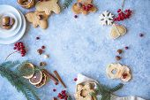 New Year And Christmas Background. Christmas Candy Cane Gingerbread On Blue Background. New Year And poster