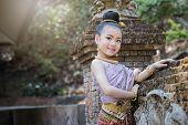 Cute Thai Girl Wearing Thai Traditional Clothing. She Posing Traditional Dancing. poster