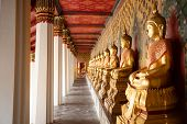 Row of Golden Buddha in Thailand. Golden Buddha statues at Temple of the Emerald Buddha, Wat Phra Ka poster