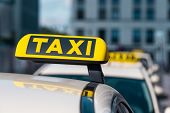 Selected focus at Taxi sign close-up on Taxi service cars poster