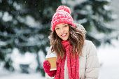 people, hot drinks and christmas concept - happy teenage girl or young woman drinking takeaway coffe poster