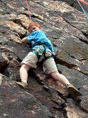 Boy Climbing On Rope