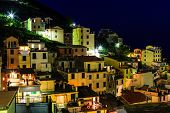 Aerial View On Illuminated Village Of  Riomaggiore At Night, Cinque Terre, Italy