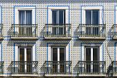 Typical Vintage Tile Facade Of A Portuguese Building With Windows, Balconies And Tiles With Geometri poster