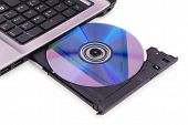 Laptop On White Background. Dvd Disc In The Drive.