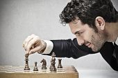 picture of winner man  - young business man playing chess - JPG