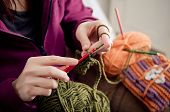 stock photo of handicrafts  - Close up of hands crocheting with wool