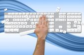 Hand breaking white and grey keyboard on blue wave background