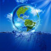 Water Earth globe over ocean waves