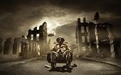 pic of doomsday  - Post apocalyptic survivor in gas mask destroyed city in the background - JPG
