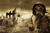 stock photo of gases  - Post apocalyptic survivor in gas mask destroyed city in the background - JPG