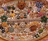 pic of vintage jewelry  - This is an assortment of vintage rhinestone pieces arranged on a mirror - JPG