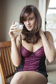 Young Woman In Lingerie Drinking Scotch