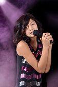 Child singing on stage