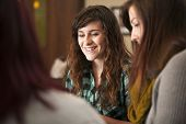 pic of scriptures  - A group of young women sit together and smile - JPG