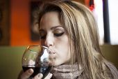 Young Woman With Closed Eyes Drinking Red Wine