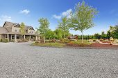 picture of driveway  - Large farm country house with gravel driveway and green landscape - JPG