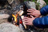 Hands At Campfire