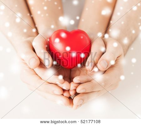 family, charity, healthcare, health. christmas, x-mas and happy people concept - woman and man hands poster