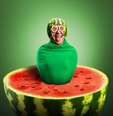 image of maggot  - Funny man with watermelon helmet and googles looks like a parasitic caterpillar - JPG