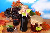 stock photo of elderberry  - homemade elderberry juice or wine and preserves with fresh fruits in the basket - JPG