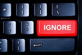 stock photo of ignorant  - Red IGNORE button on a computer keyboard - JPG