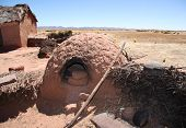 Traditional village with a clay oven in Bolivia