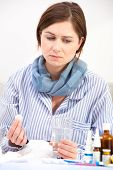 Sick Young Woman Taking Medicine