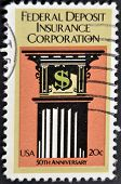 stamp shows image commemorating the 50th anniversary of the Federal Deposit Insurance Corporation