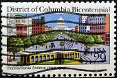 stamp printed by United States of America shows Capitol building from Pennsylvania avenue