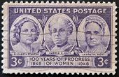 A stamp printed in the USA shows Elisabeth Stanton Carrie Catt and Lucretia Mott