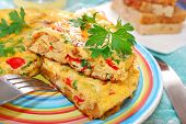 stock photo of italian parsley  - frittata with chanterelleonionred pepper and parsley for autumn breakfast or lunch - JPG