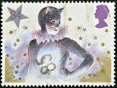 A stamp printed in Great Britain shows Pantomime Cat commemorative odd value