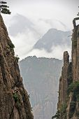 Space Between Two Vertical Rocks Reveals A Spectacular Mountain Vista, Huang Shan, China