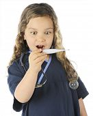 Closeup of a young elementary girl in scrubs looking shocked as she reads a thermometer.  On a white background.