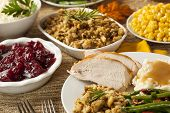 pic of gourmet food  - Homemade Turkey Thanksgiving Dinner with Mashed Potatoes Stuffing and Corn - JPG