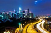 stock photo of petronas towers  - Kuala Lumpur skyline at night - JPG
