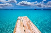 Formentera Ses Illetes beach pier Illetas with Ibiza background at balearic islands
