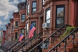 foto of brownstone  - Brownstone row houses in Sunset Park neighborhood of Brooklyn with cement stair entries  - JPG