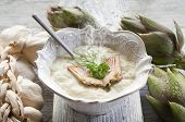 artichoke soup over bowl