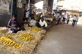 KOLKATA - NOVEMBER 28: seller sells fruits on the outdoor market on November 28, 2012 in Kolkata. On